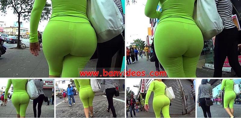 woman-wearing-green-see-through-leggins-walking-street